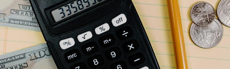 black calculator and loose money