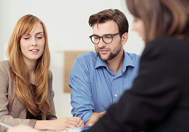 couple working with a business succession strategies lawyer